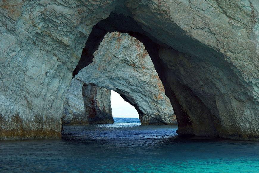 Carta da parati con foto natura Blue Caves da 120x80cm